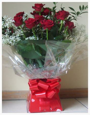 Red roses handtied Aqua pack from £30